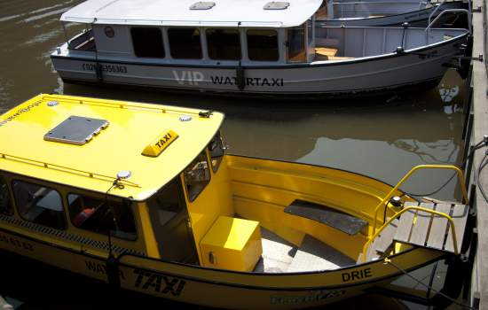 """The Amsterdam water taxis provide a near to ideal means of transport to get one to nearly any place within the city via the Amsterdam Canals. It is available both for private cruise or special arrangement. The Yellow Cab can host up to 8 persons, while the grey Ramses Shaffy, 12 persons. The vessels can moor virtually anywhere in the City.  The grey vessel has a special feature: a glass ceiling allowing for sky-view and open roof in summer.<a href=""""/thematic-categories/intermodality"""" typeof=""""skos:Concept"""" property=""""rdfs:label skos:prefLabel"""" datatype="""""""">Intermodality</a> <a href=""""/transport-modes/boat"""" typeof=""""skos:Concept"""" property=""""rdfs:label skos:prefLabel"""" datatype="""""""">Boat</a>, <a href=""""/transport-modes/canal-boat"""" typeof=""""skos:Concept"""" property=""""rdfs:label skos:prefLabel"""" datatype="""""""">Canal boat</a>"""