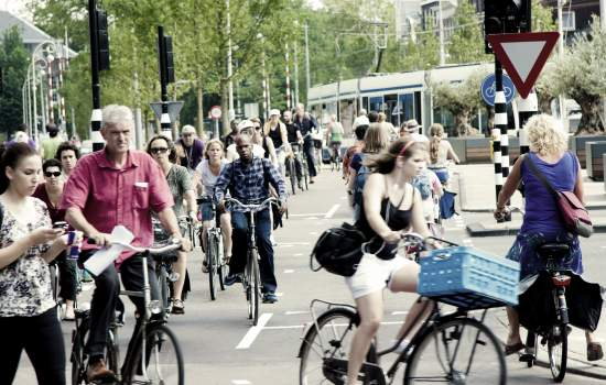 "These bikes were pictured at Amsterdam's Waterlooplein. The widespread availability of cycle paths and the bikes extensive use ensure a virtual obligation upon citizens to rely on two wheels, which practically are the easiest and fastest way to transit Amsterdam!<a href=""/thematic-categories/walking-and-cycling-enhancementsservices"" typeof=""skos:Concept"" property=""rdfs:label skos:prefLabel"" datatype="""">Walking and cycling enhancements/services</a> <a href=""/transport-modes/cycling"" typeof=""skos:Concept"" property=""rdfs:label skos:prefLabel"" datatype="""">Cycling</a>, <a href=""/transport-modes/tram"" typeof=""skos:Concept"" property=""rdfs:label skos:prefLabel"" datatype="""">Tram</a>"